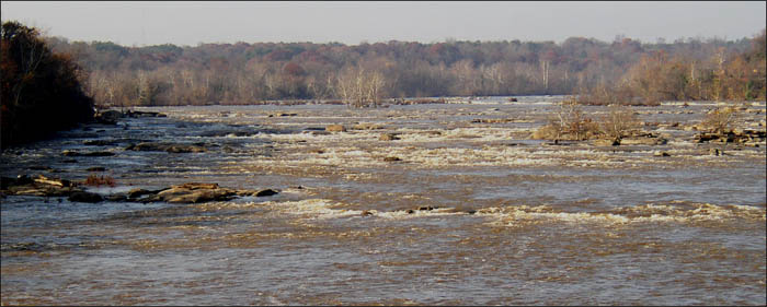 Upstream view of the James River in Richmond flowing under moderately high water conditions (~13,500 cfs, ~7' on the Richmond-Westham gage).