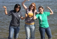 Three girls posing in the water
