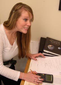Frenetic or frantic? Claire Still ('09) calculating the diameter of the Chesapeake Bay impactor.