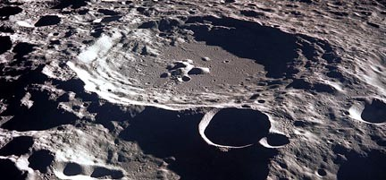 Oblique aerial view (from Apollo 11 mission) of impact craters on the Moon.