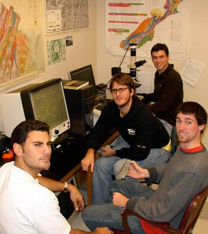 Vorticity research team (minus Lydia Murray) in the lab analyzing samples and scowling at the paparazzi.