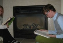 Reading Books in front of a fireplace. xCasey says all we need to be adults is books and a floor. I think the fireplace makes us classy.