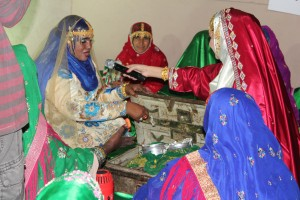 A women reenacts regional dowry traditions for the host of the nightly live program from the festival:  Asala!