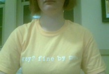 "wearing a shirt that says, ""Gay? Fine by me."""