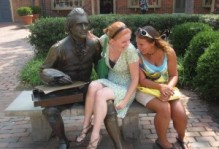 two students sitting with a Jefferson statue