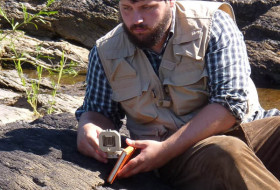 The always dapper Alex Johnson measures geologic structures.