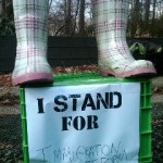 "boots on a box that reads, ""I stand for"""