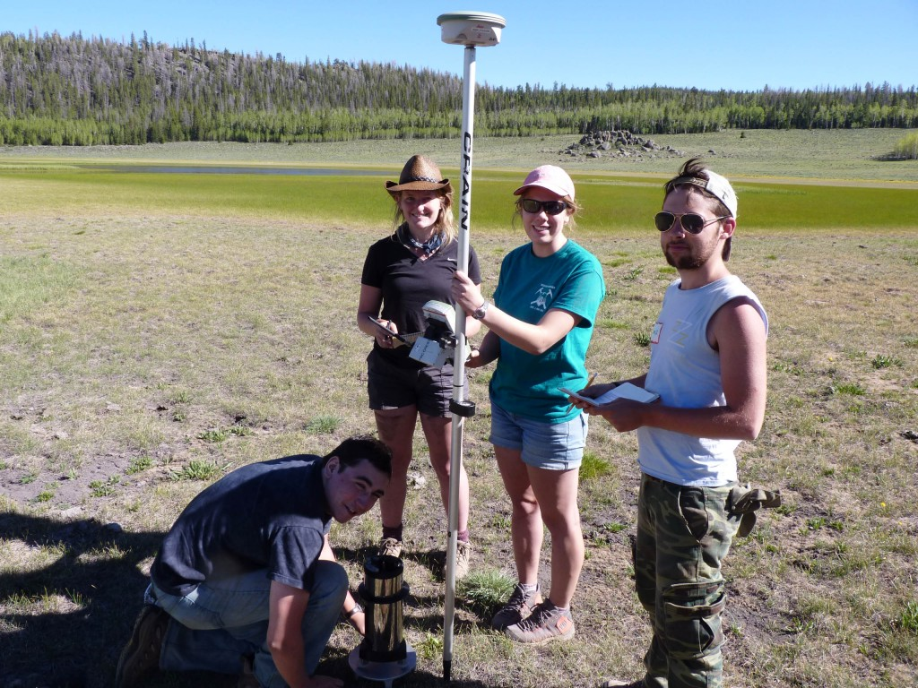 The Wayne WonderMonkeys making a gravity and elevation measurement near Fish Lake. From left to right Zack Fleming (with the gravimeter), Erika Wenrich, Hanna Bartram (holding the kinematic GPS rover), and Peter Steele.