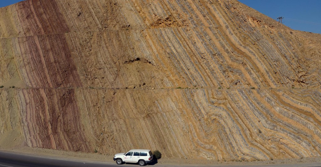 Big road cut near Nizwa, Oman exposed folded and tilted strata.
