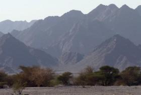 Ophiolite terrain rising above the Oman desert.