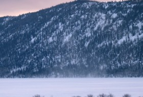View to the east of Fish Lake's frozen surface and Mytoge Mountain which rises steeply from the southeastern shore of the lake.