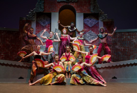 Chinese dance performance with fans and colorful costumes