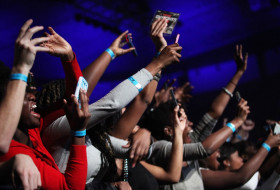 students cheering at a Charter Day Concert