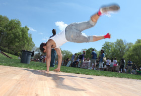 Student break dancing in Sunken Garden at Day for Admitted Students