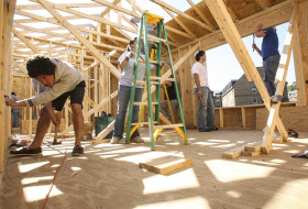 students and leaders constructing a house on Barksdale Field