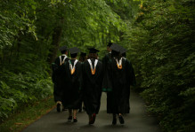 graduates walking through the wildlife refuge in regalia