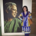 Wearing a traditional kameez next to a picture of Mohammed Yunus, 2006 Nobel Peace Prize winner and founder of the Grameen Bank.