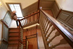 person walking up the stairs in one of our historic buildings