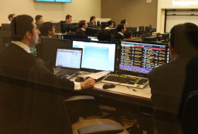 Students in suits at computers in the Mason School of Business