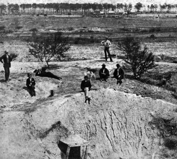Post Civil War photo of the Crater with tourists for scale.  Note the remains of the Union tunnel and steep slopes at the site.
