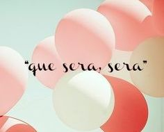 "a card that has balloons and reads ""que sera, sera"""