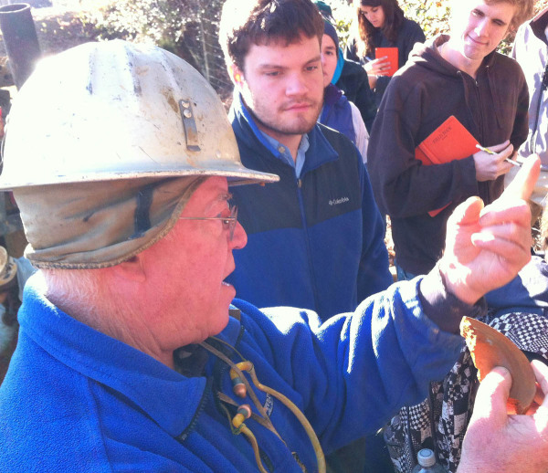 Rick Berquist (in the hard hat) has the Field Methods students mesmerized as they discuss sediment at the North Anna Battlefield Park.