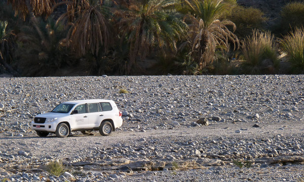 The LandCruiser parked on the Road to the Moho, Wadi Abyad, Oman.
