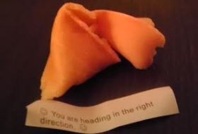"a fortune cookie with the fortune that reads, ""You are heading in the right direction"""