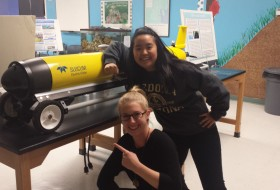 McCluskey and Hong point to an autonomous underwater gliding vehicle used during January's lab on gliders.
