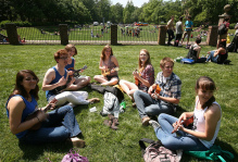 students play ukuleles on the sunken gardens