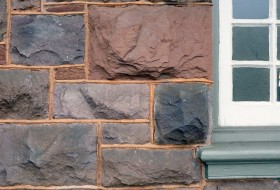 Hewn blocks of Triassic Midway Mills sandstone in the exterior wall of the old Norfolk & Western Railway's Bedford (Liberty) station. The building was constructed in the 1880s and currently houses the Liberty Station Restaurant.