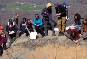 Measuring geologic structures at the Greenstone Overlook, Blue Ridge Parkway.