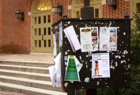 message board outside the marketplace at William and Mary