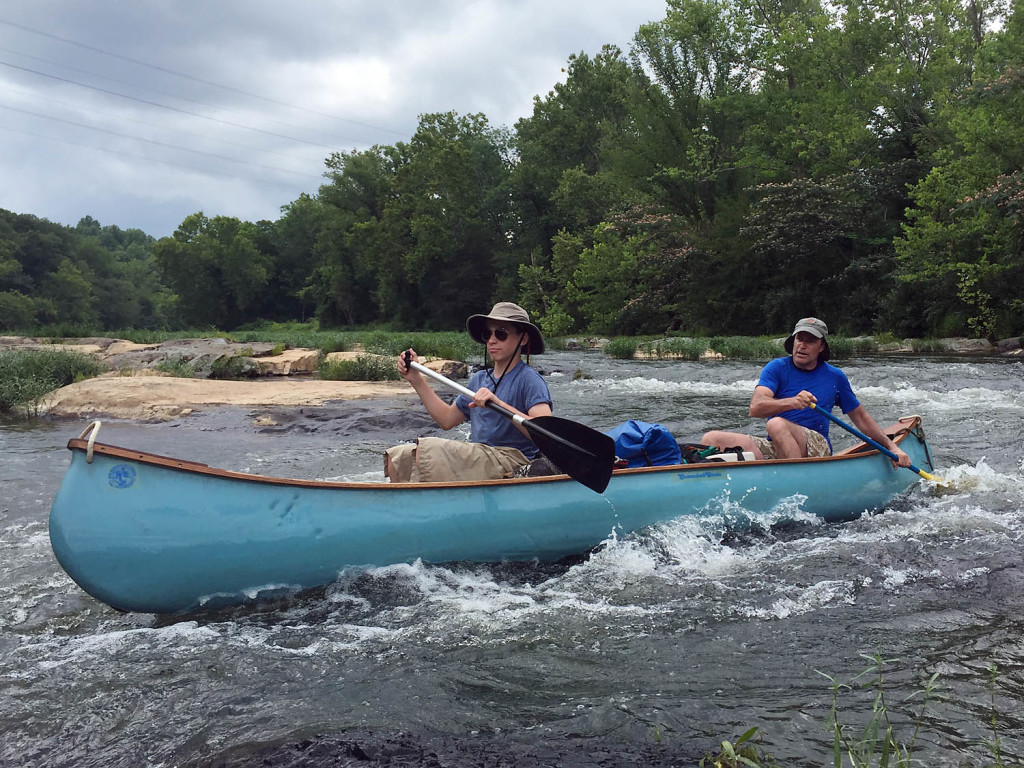 Stuart and Todd Beach slicing through rapids on the Rivanna River near Monticello.