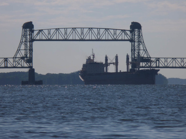 The Benjamin Harrison Bridge with an ocean-going vessels passing under the drawbridge.