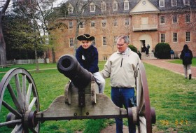 a young child on a cannon in front of the wren building