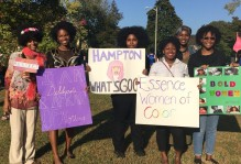 Some of the members of E.S.S.E.N.C.E Women of Color at homecoming 2015. We were playing Hampton University, hence the signs. Can you guess the theme these ladies are dressed to?