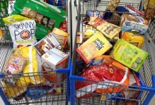 two shopping carts full of snacks