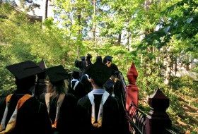 graduating class walking over the crim dell
