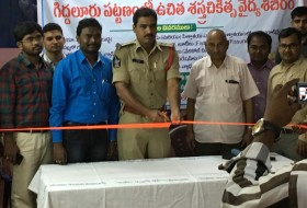 Opening ceremony of the medical camp by a police officer with doctors surrounding him.
