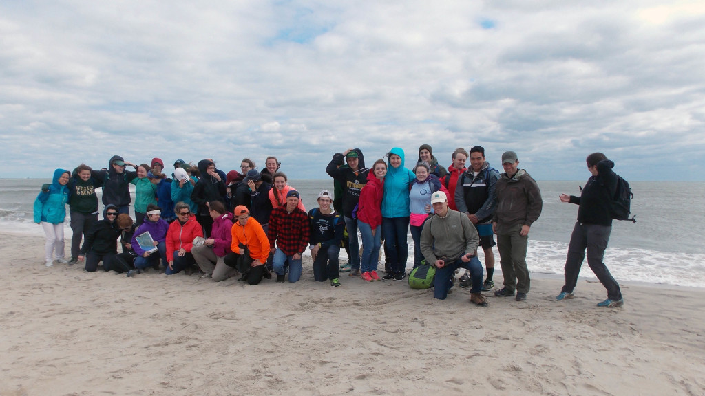 On the beach and struggling with the group pose at Assateague Island beach