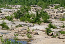 Expansive outcrops of Petersburg Granite exposed in the old channel of the James River, south of Belle Isle.