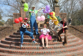 students dressed as Mario characters on the steps of the sunken garden