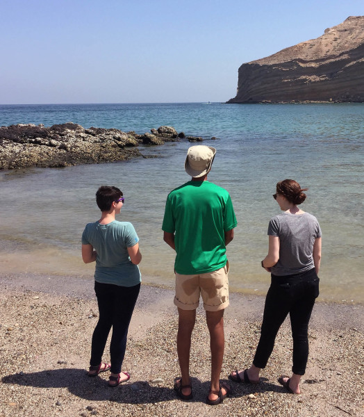 Lauren Visokay ('18), Moussa Dia ('18), and Cece Hurtado ('17) enjoying the beach at Qantab, Oman.