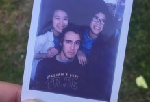 polaroid photo of 3 students