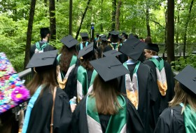 Walking to the School of Education with my cohort to receive our degrees
