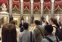 a tour group on the inside of the capital building