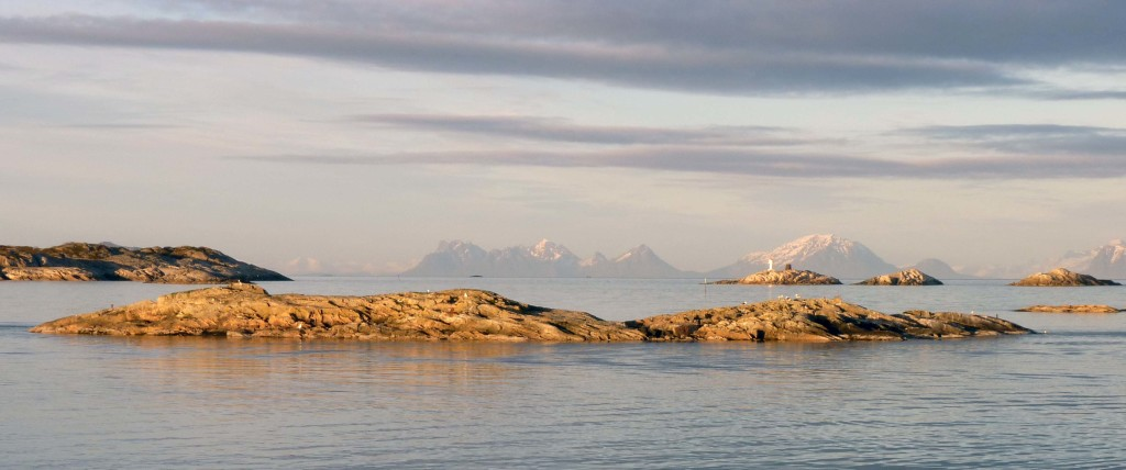 Skerries, just offshore from Henningsvær, in the late evening Arctic sunlight.