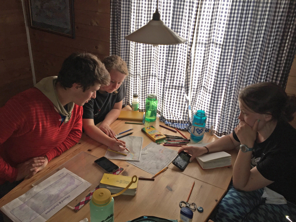 Josh Himmelstein, Katie Lang, and Hope Duke working late into the Arctic 'night' on their Trolldalen map.