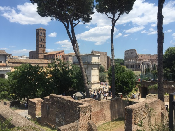 A view of the Roman Forum with the Colosseum in the background